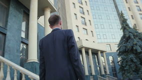Young, personable businessman sent to the office building. stock footage