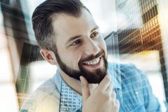 Young perspective man holding hand near beard and smiling. Successful man. Young busy perspective man holding hand near beard smiling and looking aside Royalty Free Stock Photography