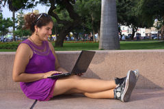Young Peruvian Woman with Laptop in Park. Beautiful smiling young Peruvian woman with laptop computer in a park in Lima, Peru (Selective Focus, Focus on the face Stock Images