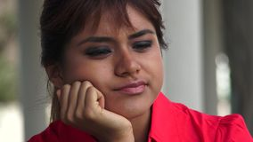 Young Peruvian Woman Thinking. A pretty young Peruvian adult female stock footage
