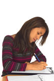 Young Peruvian Woman Writing Stock Image