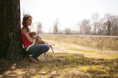 Young pet dog breeds beagle walking in the park outdoors. Young pet dog breeds beagle walking in park outdoors. woman carefully walks puppy, plays and Royalty Free Stock Image