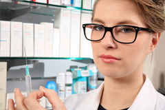 Young pharmacist holding an injection Stock Photography