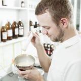 Young pharmacist preparing medicine Stock Photos