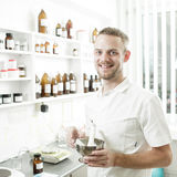 Young pharmacist preparing medicine Stock Images