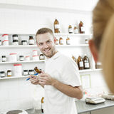 Young pharmacist preparing medicine Royalty Free Stock Photography