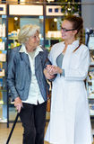Young pharmacist and senior patient Royalty Free Stock Photo