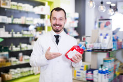 Young pharmacist suggesting useful drug Stock Image