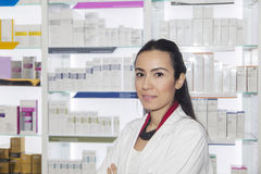 Young pharmacist woman in drug store Stock Photo