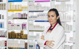 Young pharmacist woman in drug store Royalty Free Stock Image