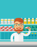Young  pharmacy chemist man standing in drugstore Stock Image