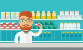Young  pharmacy chemist man standing in drugstore Stock Photo