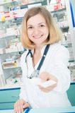 Young pharmcist in drugstore Royalty Free Stock Images