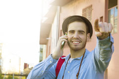 Young with the phone mobile. Male young with the phone mobile in the street of the city Royalty Free Stock Photos
