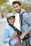 Young photo reporters in town working Royalty Free Stock Photos