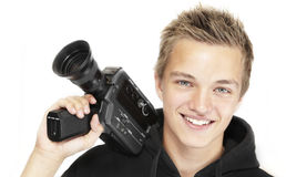 Young photographer. A young photographer with a 8mm camera Royalty Free Stock Images