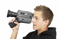 Young photographer. A young photographer with a 8mm camera Royalty Free Stock Photos