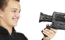 Young photographer. A young photographer with a 8mm camera Royalty Free Stock Image