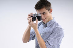 Young photographer. Young, talented, young man learning to use one camera Stock Photos