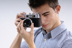 Young photographer. Young, talented, young man learning to use one camera Royalty Free Stock Photos
