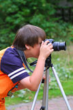 Young photographer. Takes pictures on the nature Royalty Free Stock Photos