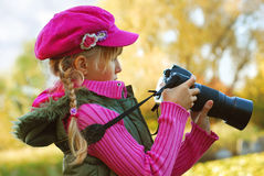 Young photographer in autumn park Royalty Free Stock Images