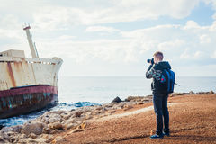 Young photographer on the beach Royalty Free Stock Photo