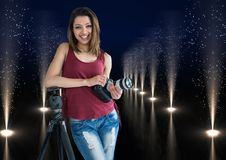 Young photographer with camera on hands and rest on the tripod in lights corridor. Digital composite of young photographer with camera on hands and rest on the Royalty Free Stock Images