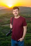 Young photographer enjoying sunset Royalty Free Stock Images