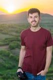 Young photographer enjoying sunset Stock Photo