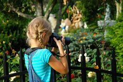 Young photographer in the garden Royalty Free Stock Image