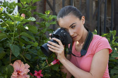 Young Photographer In Garden Royalty Free Stock Images