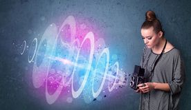 Photographer girl making photos with powerful light beam Stock Photography