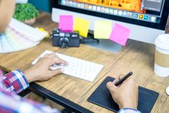 Young photographer and graphic designer working design artwork at office. Graphic designer concept stock photo
