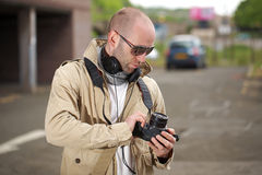 Young photographer with his dslr camera, outdoor Royalty Free Stock Images