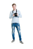 Young photographer holding a dslr photo camera Royalty Free Stock Images