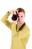 Young photographer (isolated on white). Young photographer with camera(isolated on white royalty free stock photography