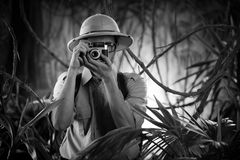 Young photographer in the jungle Stock Photography