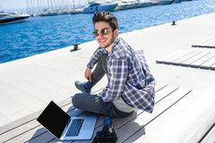 Young photographer with laptop and photo camera Stock Photos