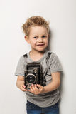 Young photographer. Little boy hold vintage camera Stock Images