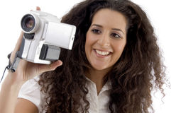 Young photographer making video with handy cam Stock Image