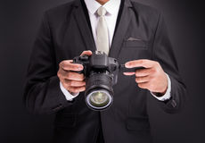 Young photographer man holding camera Stock Photo