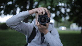 Young photographer with professional digital SLR camera stock video footage