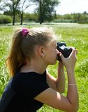Young photographer. And reflex camera. Children photographing Stock Photo