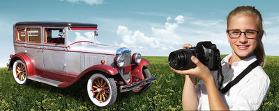 Young photographer and retro car Stock Photo