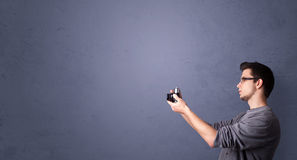 Young photographer shooting images with copyspace area Royalty Free Stock Images