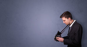 Young photographer shooting images with copyspace area Royalty Free Stock Image