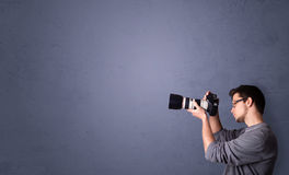 Young photographer shooting images with copyspace area Royalty Free Stock Photography