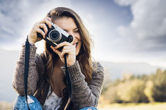 Young photographer shooting in nature Royalty Free Stock Photos