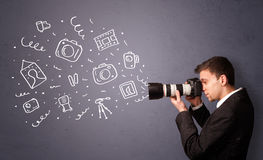 Young photographer shooting photography icons Stock Image